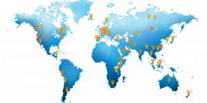World map with orange pins indicating where students have worked